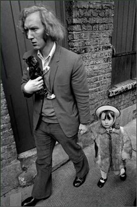 Europe. England. London. Whitechapel. Man With His Daughter And Kitten In London's East End